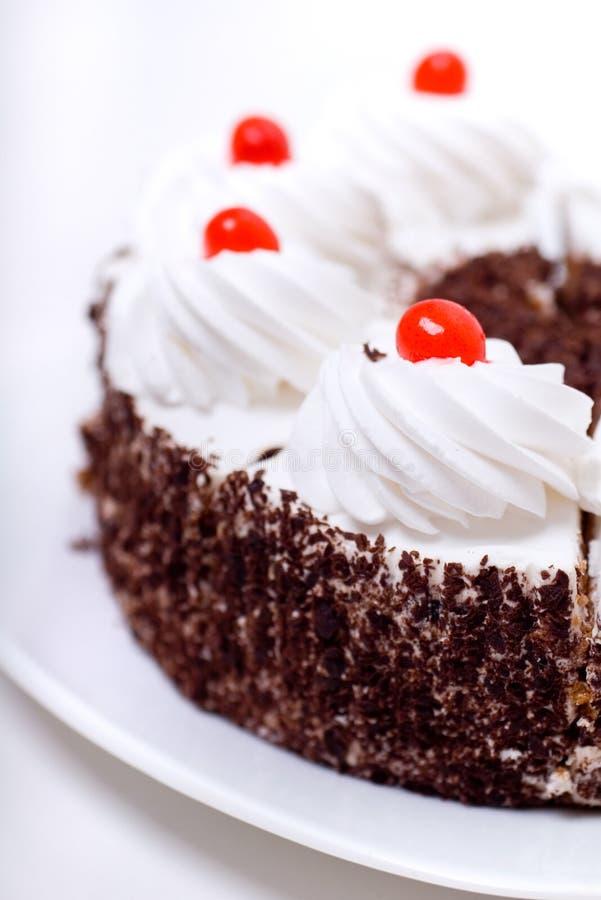 Torta deliciosa con crema azotada imagenes de archivo