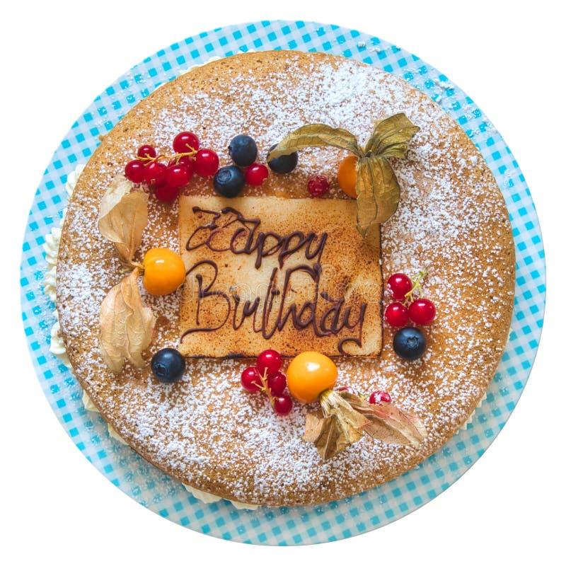 Torta di compleanno con il messaggio convogliato nella scrittura del cioccolato con il ` di buon compleanno del ` di parole isola fotografie stock