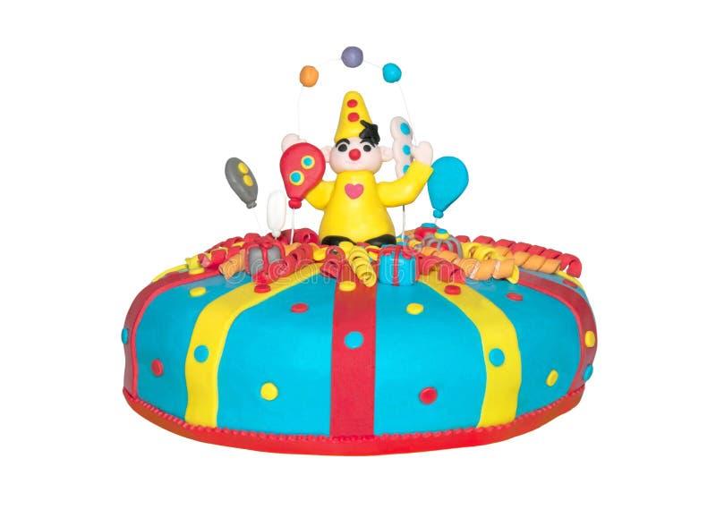 Torta di compleanno con un pagliaccio immagine stock libera da diritti