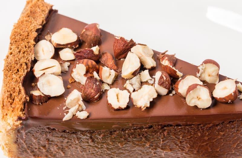 Torta di formaggio del cioccolato con le nocciole fotografia stock