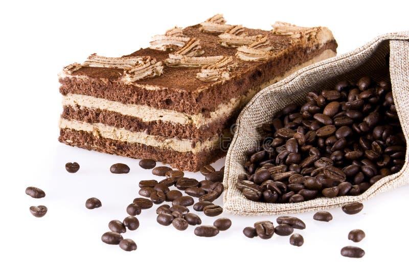 Torta di Tiramisu con il sacchetto di coffe fotografie stock libere da diritti