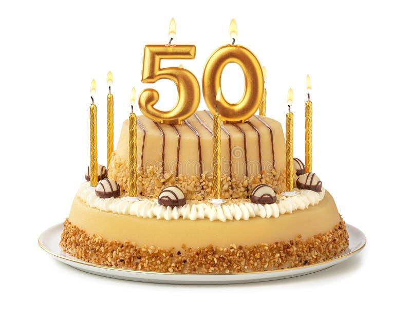 Torta festiva con las velas de oro - número 50 imágenes de archivo libres de regalías