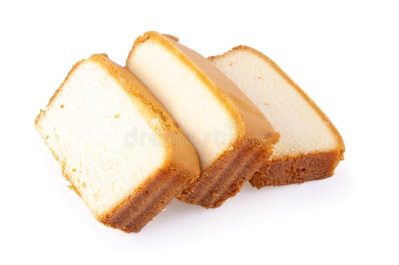 Torta húmeda cortada de la mantequilla aislada en el fondo blanco imagen de archivo