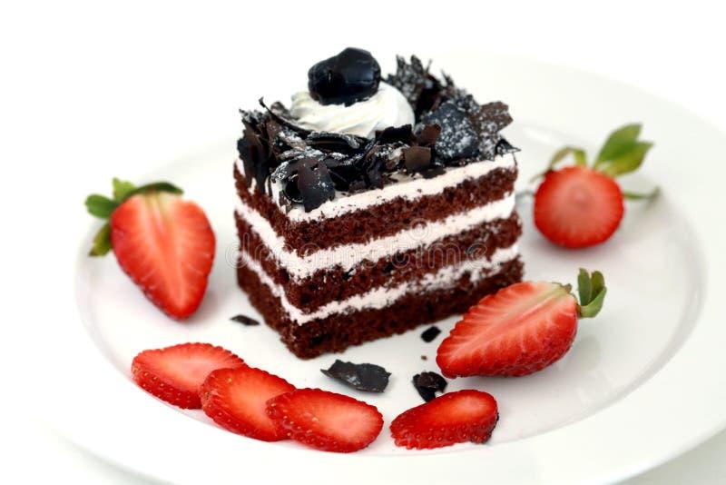 Torta y fresas de chocolate foto de archivo