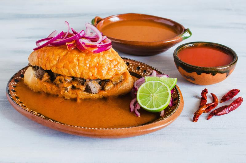 Tortas ahogadas, traditional Mexican Food from Jalisco Guadalajara Mexico, spicy sandwich in a red sauce royalty free stock photography