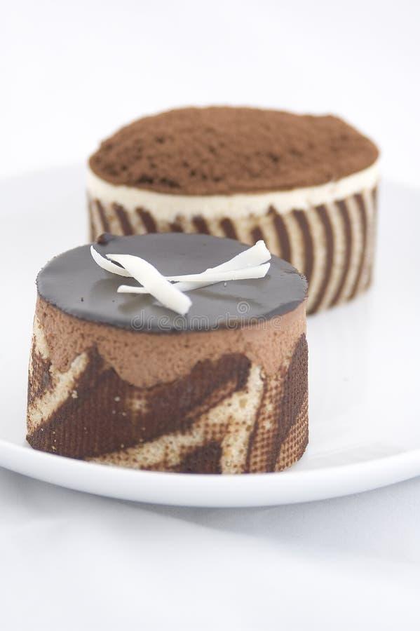 Tortas de chocolate imagenes de archivo