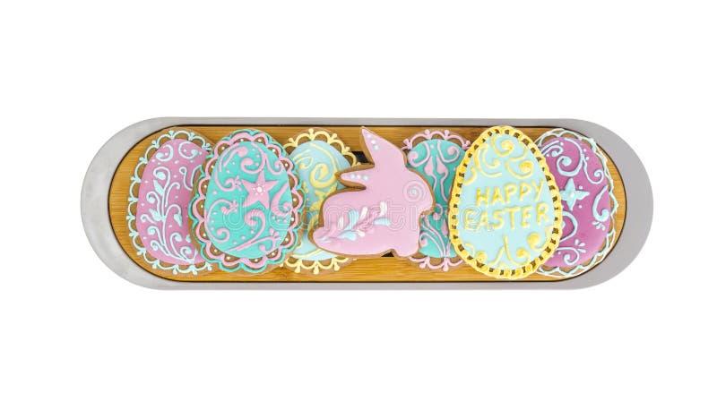 Tortas hechas en casa, galletas del pan de jengibre en la forma de los huevos de Pascua con la formación de hielo fotos de archivo libres de regalías