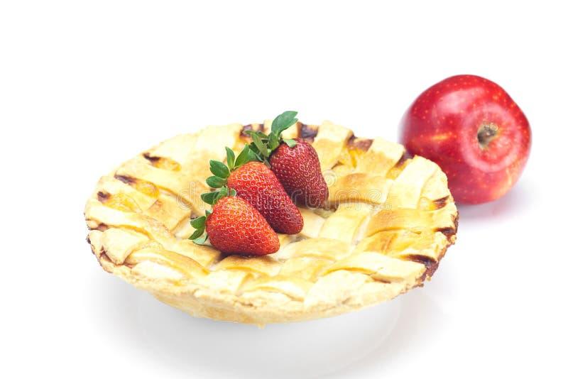 Torte, Äpfel und Erdbeeren stockbilder