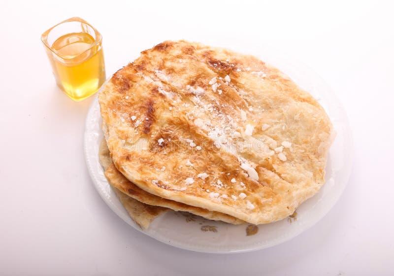 Torte mit suger und Honig lizenzfreie stockfotos