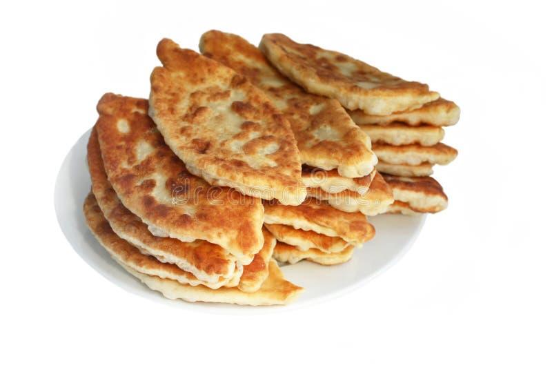 Torte (Pierogi, pirogi), russisches Traditionsgebäck lizenzfreie stockbilder