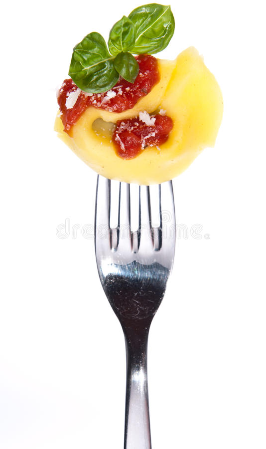 Tortellini on a fork isolated on white stock images