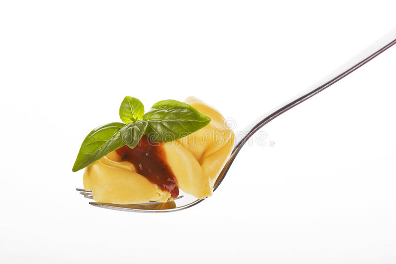 Tortellini with pasta on fork. stock photography