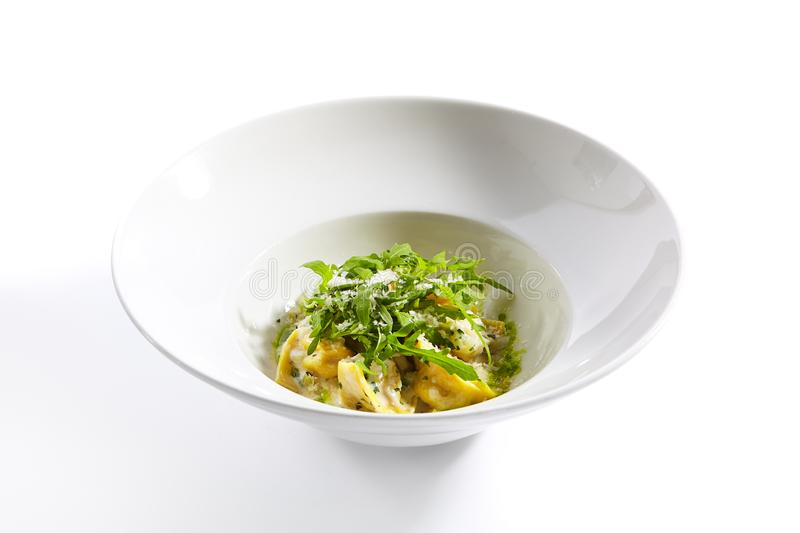 Tortellini with rabbit meat pesto sauce and arugula close up royalty free stock photos