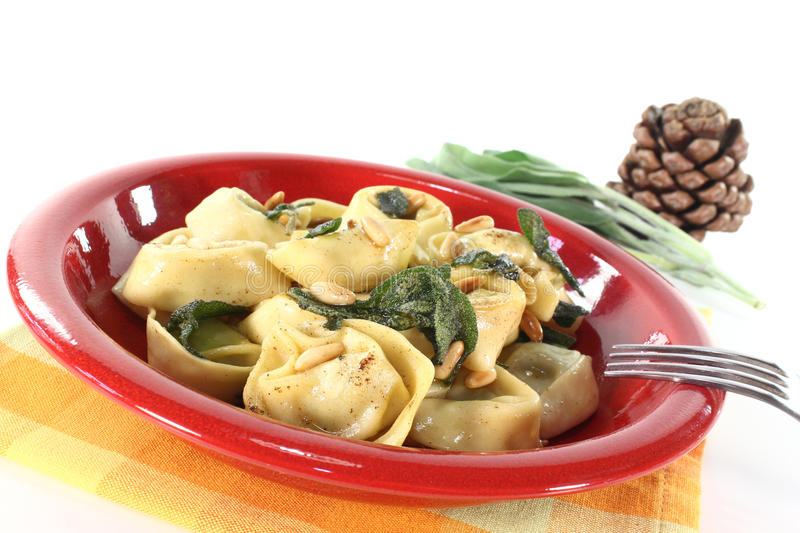 Tortellini with sage. Fresh tortellini with sage butter and pine nuts royalty free stock images