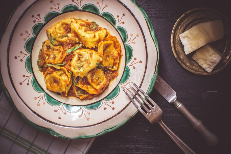 Tortellini with Tomato Sauce, Mozzarella Cheese and Basil on Rustic Plate royalty free stock photos