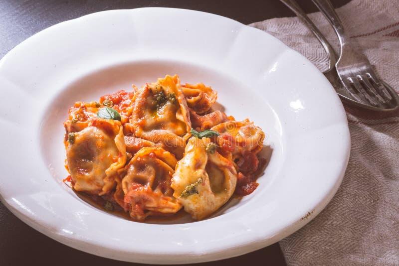 Tortellini with Tomato Sauce and Mozzarella Cheese stock images