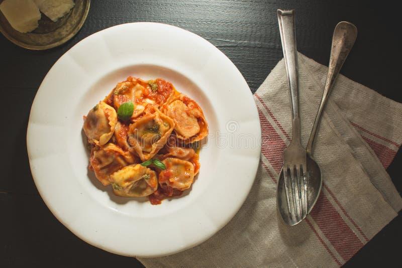 Tortellini with Tomato Sauce and Mozzarella Cheese stock photo