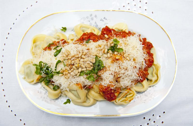 Tortelloni. On the white porcelain plate stock photos