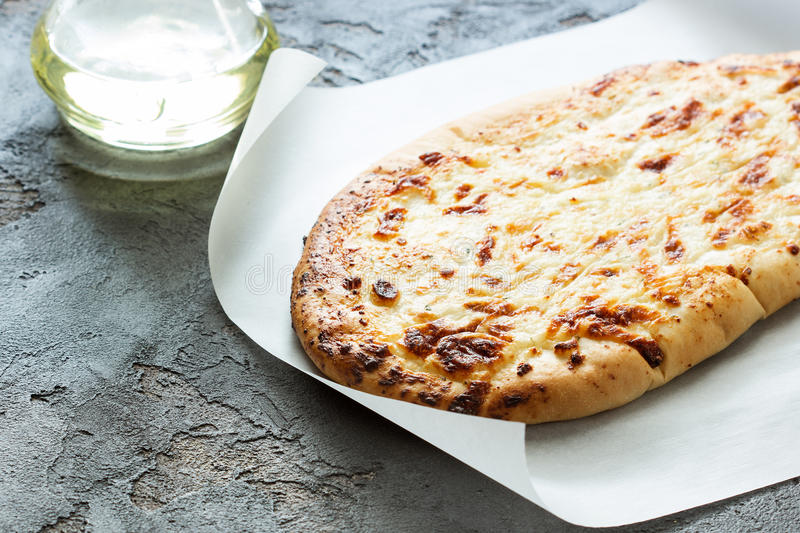 Tortilla with baked cheese, extra virgin olive oil on a concrete stock images