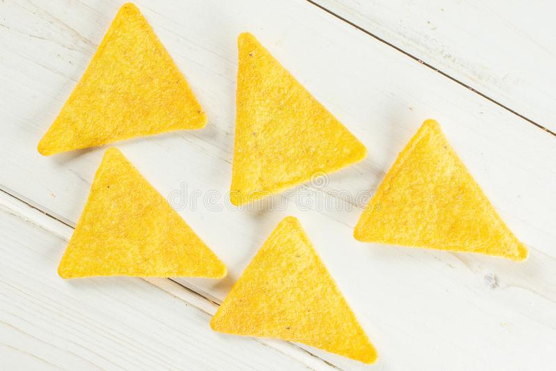 Tortilla cheese chips on grey wood royalty free stock images