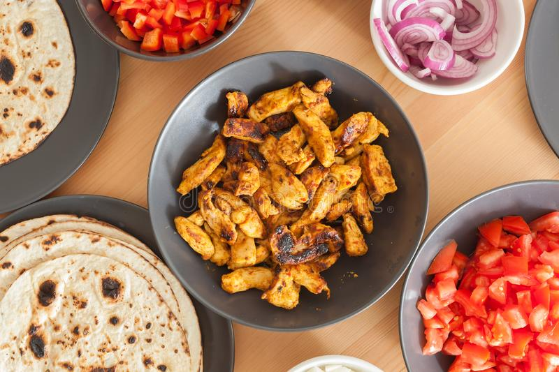 Tortilla with chicken meat. Tortilla served with paprika, onion, sauce and chicken meat royalty free stock photo