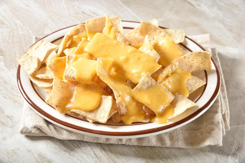 Tortilla chips with cheese sauce stock photo