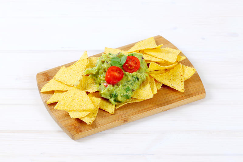 Download Tortilla Chips With Guacamole Stock Photo - Image of portion, sauce: 83708676
