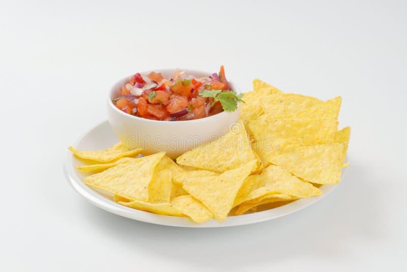 Tortilla chips and tomato salad royalty free stock photo
