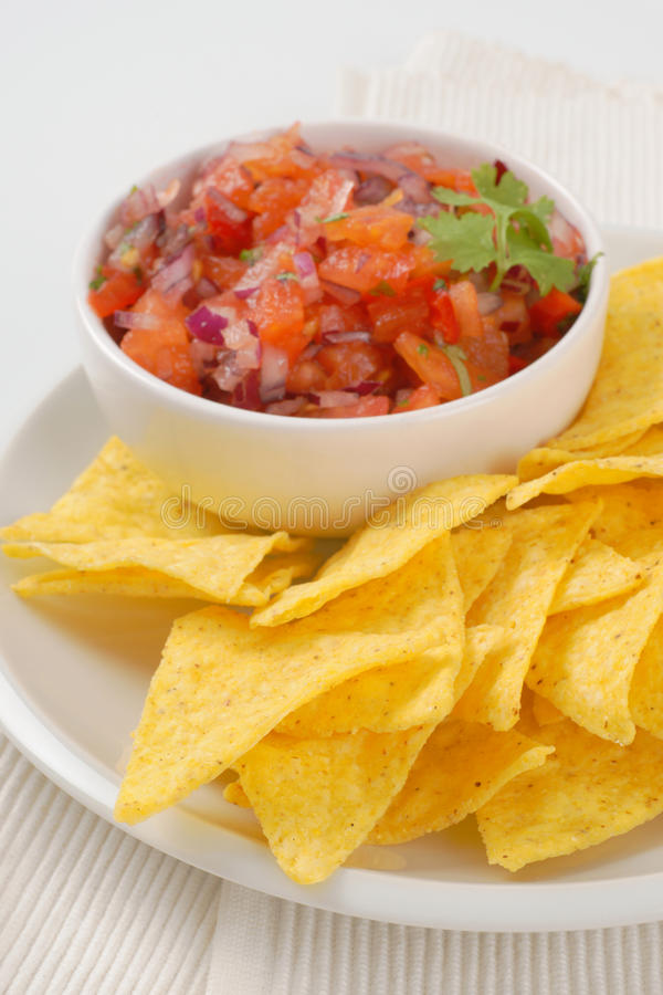 Tortilla chips and tomato salad royalty free stock images