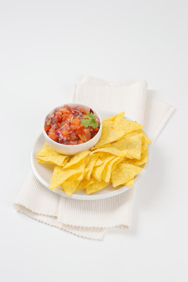 Tortilla chips and tomato salad royalty free stock photography