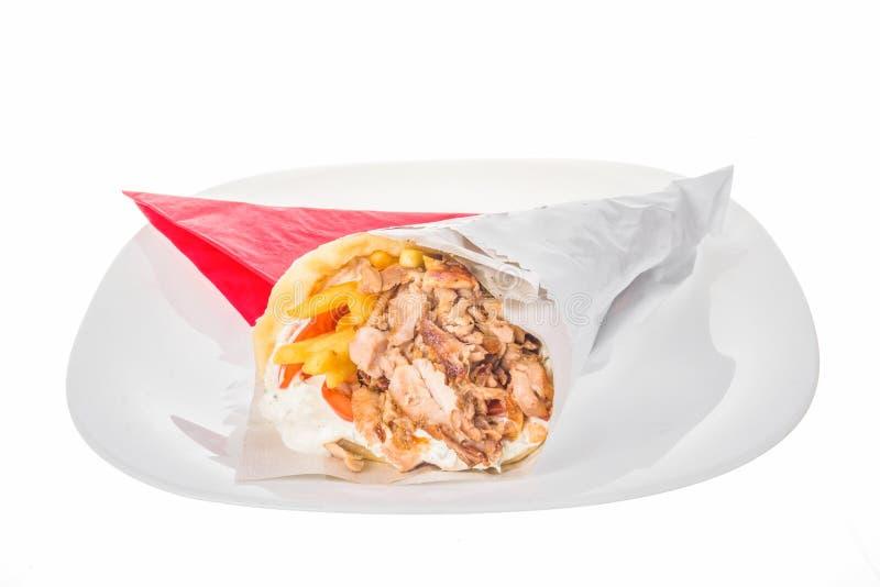 Tortilla de chiche-kebab avec de la viande et les pommes frites grillées images stock