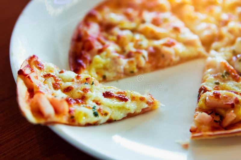 Tortilla Pizza with mozzarella cheese, imitation crab stick, sweet corn and pineapple. royalty free stock photos