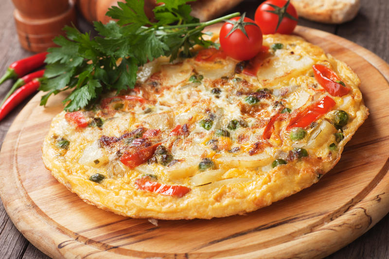Tortilla, spanish omelet with potato and vegetables royalty free stock photos