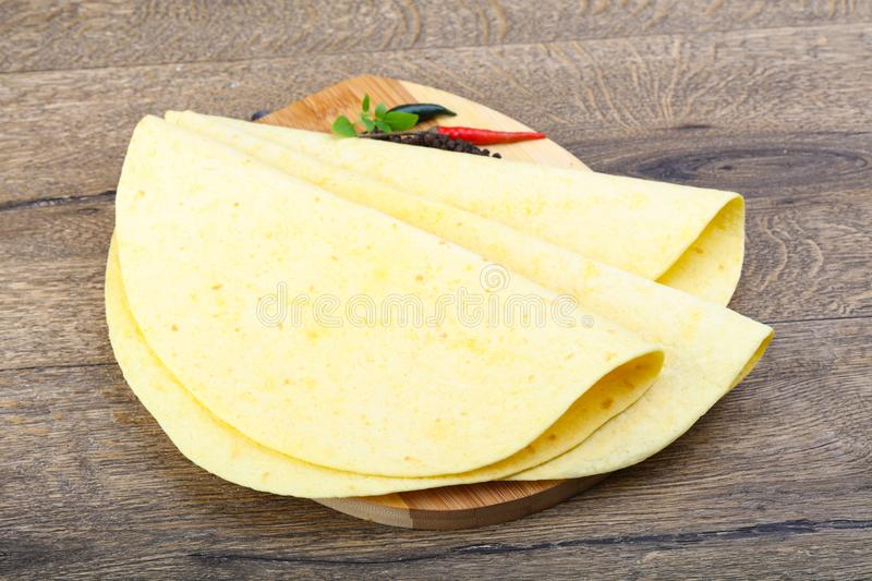 Tortilla on the wood background royalty free stock image