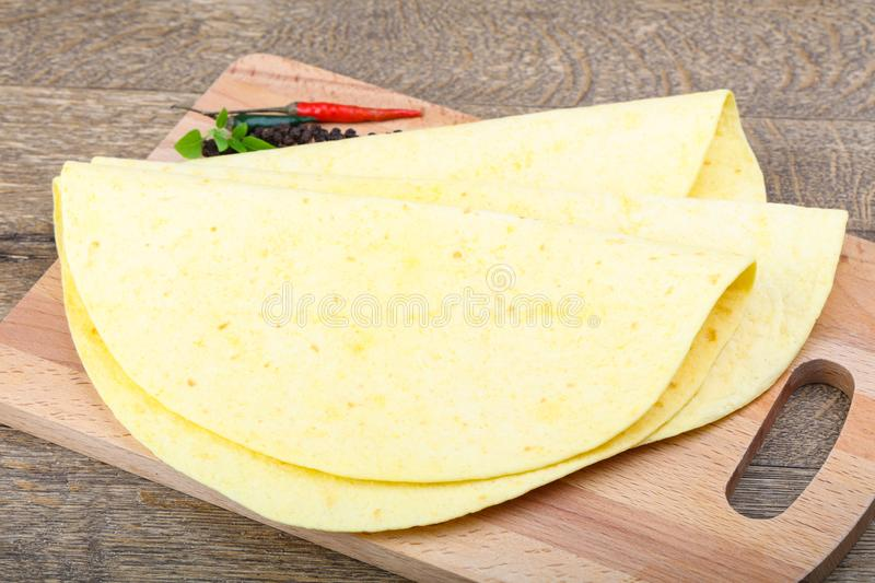 Tortilla on the wood background royalty free stock images