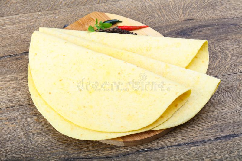 Tortilla on the wood background royalty free stock photo