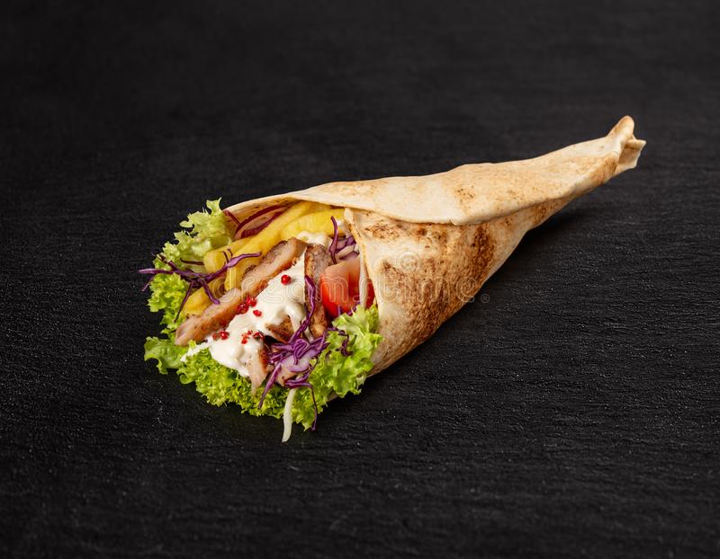 Tortilla wrap with fried chicken meat royalty free stock images