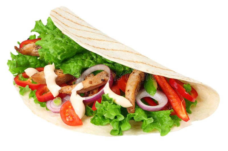 Tortilla wrap with fried chicken meat and vegetables isolated on white background. fast food stock image