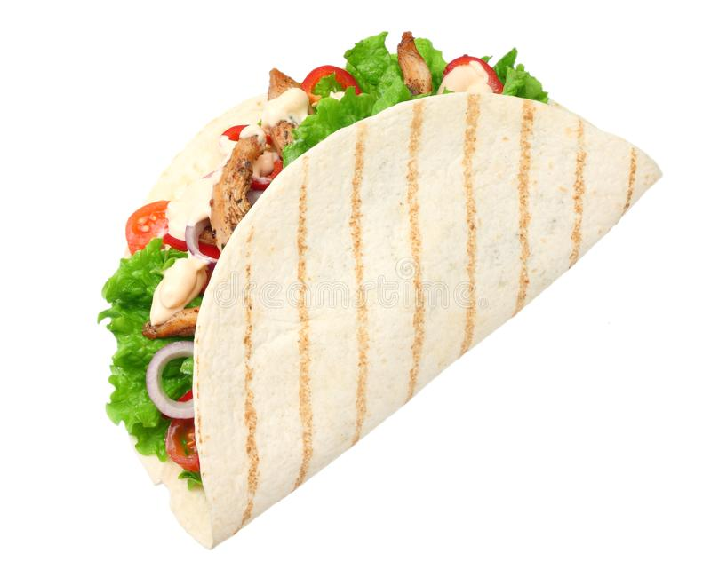 Tortilla wrap with fried chicken meat and vegetables isolated on white background. fast food royalty free stock photography