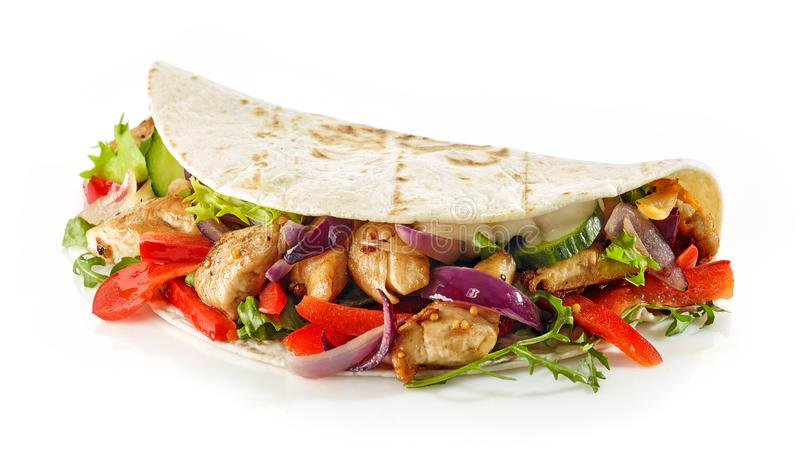 Tortilla wrap with fried chicken meat and vegetables royalty free stock photography