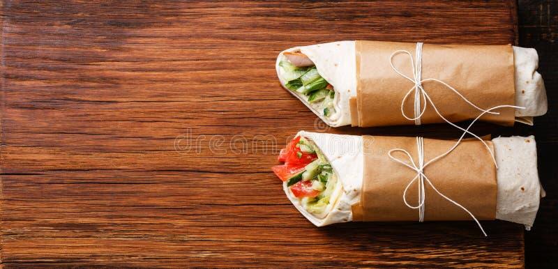 Tortillan slår in smörgåsar royaltyfria bilder