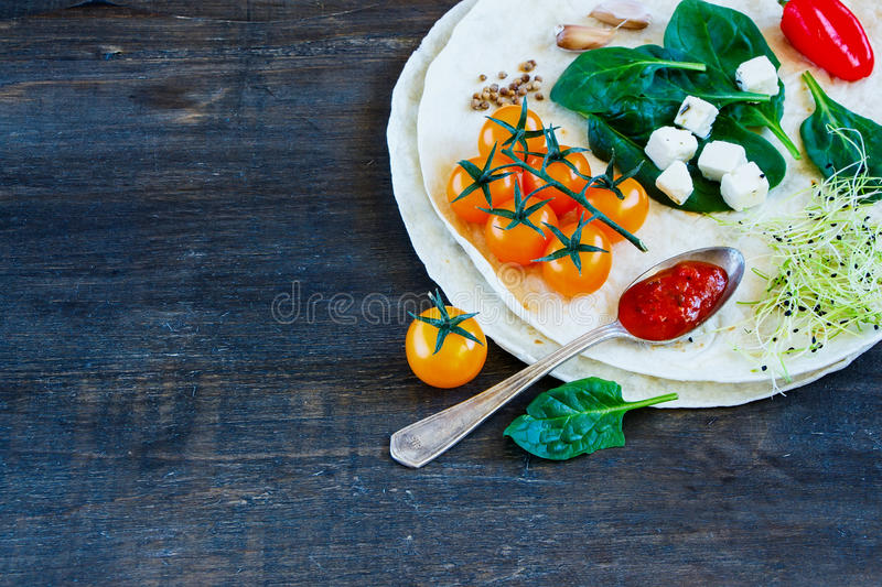 Tortillas flat and vegetables royalty free stock photos