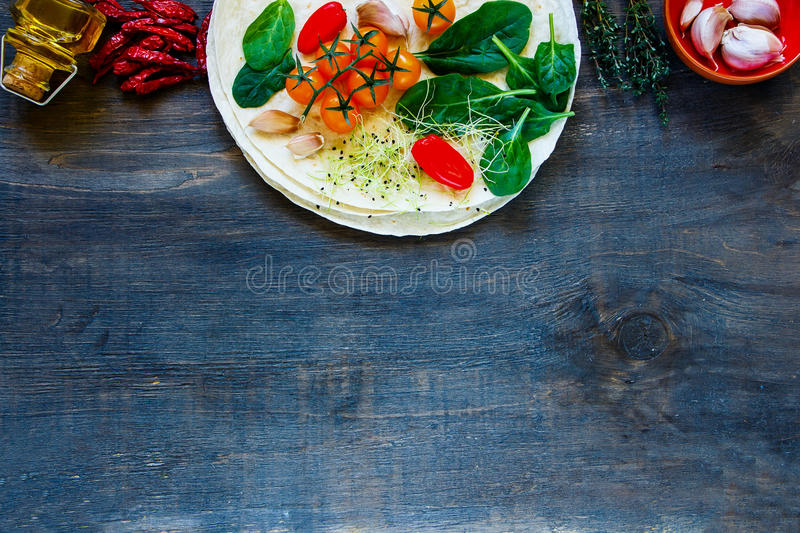 Tortillas flat and vegetables royalty free stock image