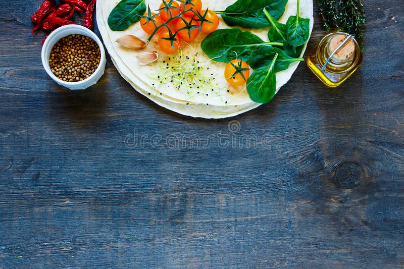 Tortillas flat and vegetables royalty free stock photography