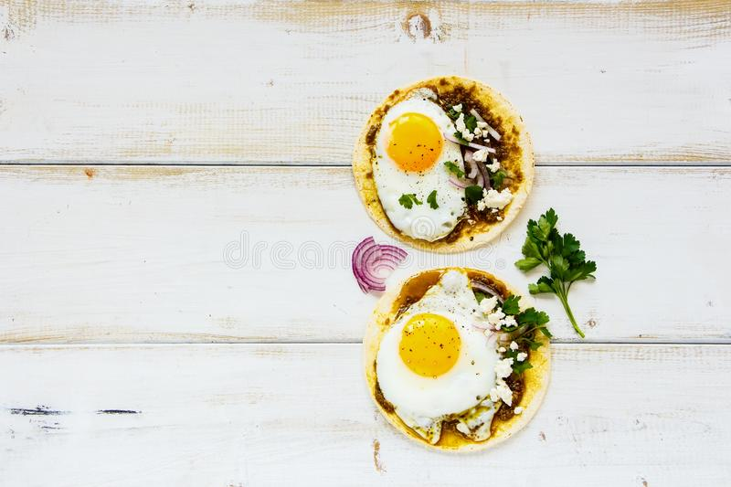 Tortillas with fried eggs stock images
