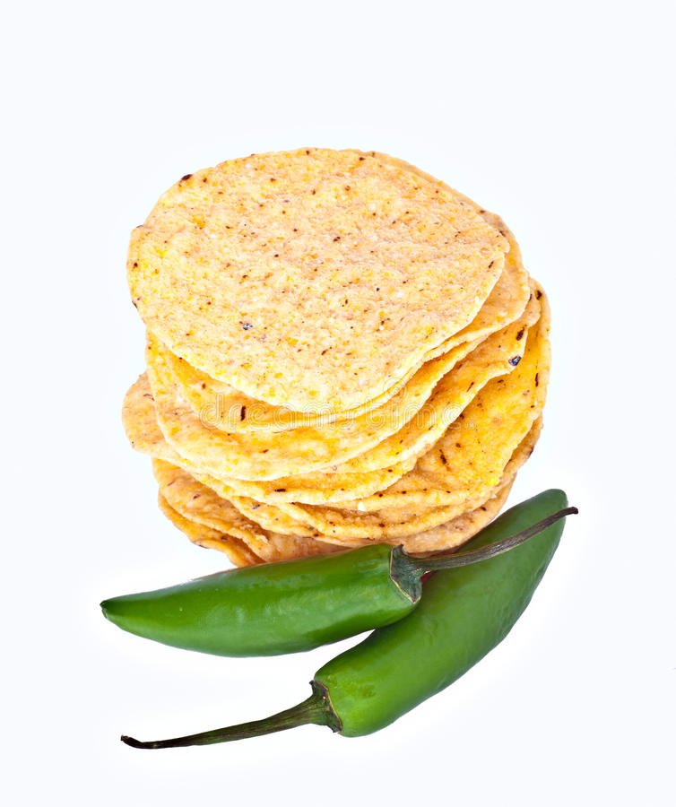 Tortillas and jalapeno. Stack of Corn Tortillas and Jalapeno Peppers isolated on white stock photography