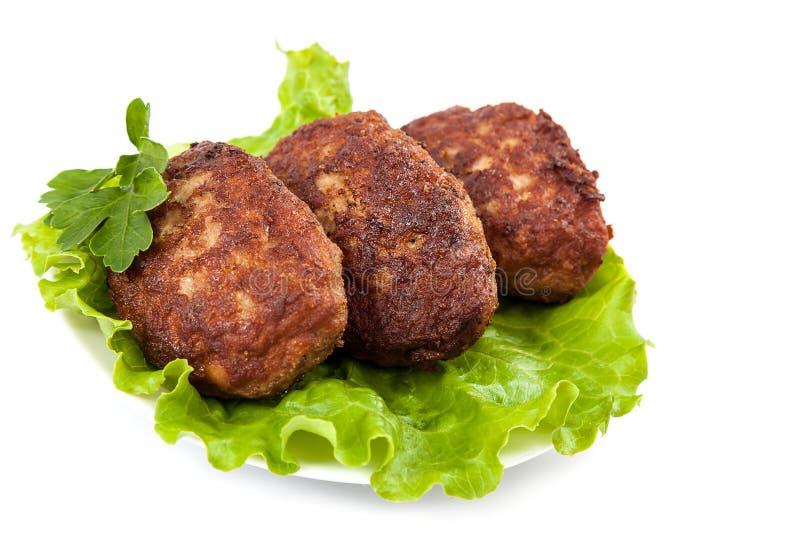 Tortini della carne con lattuga fresca immagine stock libera da diritti