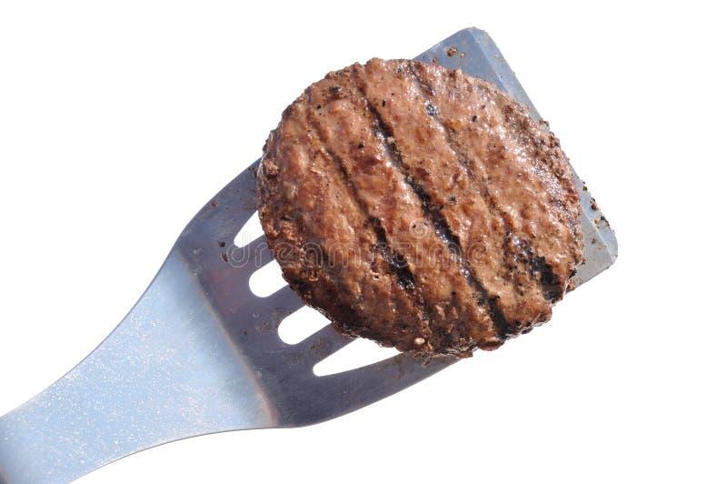 Tortino cotto dell'hamburger su una spatola fotografie stock