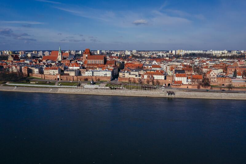 Torun city in Poland. Drone view of historic part of Torun city over Vistula River in Poland with St John the Baptist Cathedral and Church of Holy Spirit, old royalty free stock photo