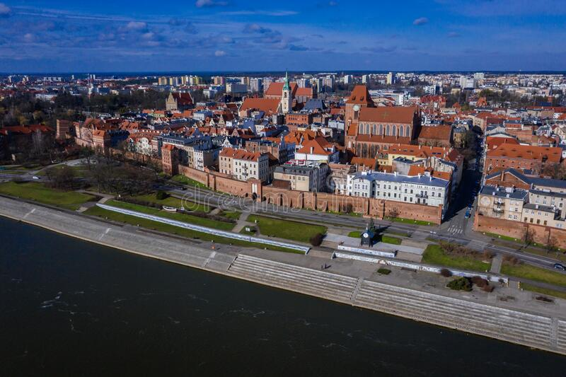 Torun city in Poland. Drone view of historic part of Torun city over Vistula River in Poland with St John the Baptist Cathedral and Church of Holy Spirit, old stock photos